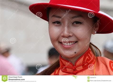 Young Mongolian Women Smiling At The Camera Editorial