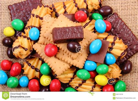 A Lot Of Sweets On Jute Burlap, Unhealthy Food Stock Photo