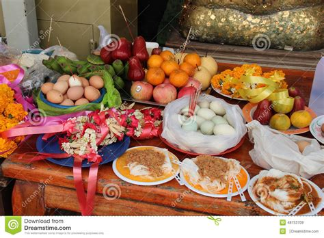 Food Was Put As Offerings On A Table In The Courtyard Of A