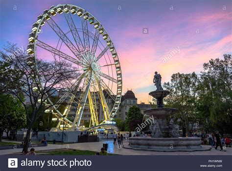 The Budapest Eye at dusk with a dramatic sky after sunset